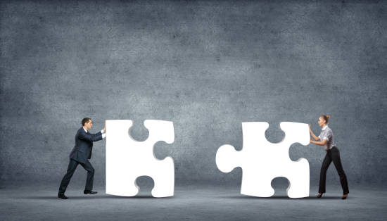 Team,Of,Business,People,Collaborate,Holding,Up,Jigsaw,Puzzle,Pieces